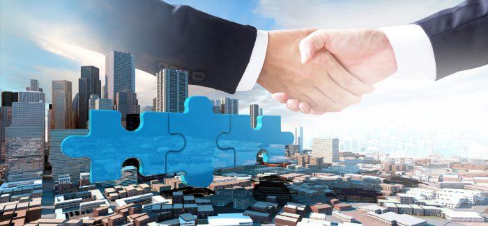 Eleição e disputas comerciais reduzem fusões e aquisições